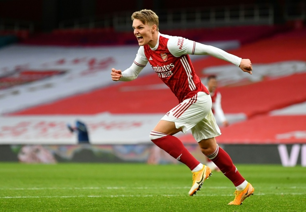 Odegaard will return to play in the Premiership. AFP