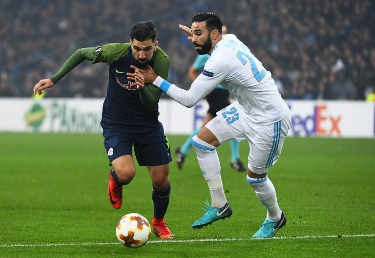 Prochain article Article précédent Pin Adil Rami lors du match d'Europa League face à Salzbourg. AFPWhatsappTwitterFacebookCommentaires 0