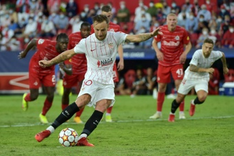 Rakitic, un goleador histórico para el Sevilla en Champions. AFP