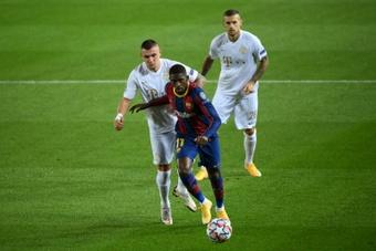 Al Barça le gustaría dejar atado ya a Dembélé, pero cree que su agente tiene otros planes. AFP