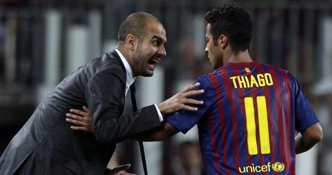 Pep Guardiola y Thiago, en el Barcelona
