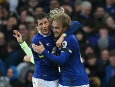The Everton players are celebrating their victory. AFP