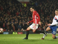 Manchester United's Henrikh Mkhitaryan limps out after match. AFP