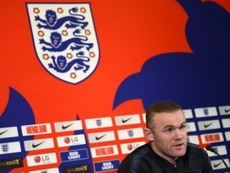 Rooney will return to England duty. AFP