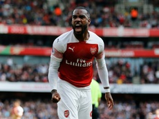Alexandre Lacazette has revealed that he prefers playing in French stadiums to English ones. AFP