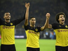 Achraf (C) is having a great season at Dortmund and he could well return to Real Madrid. AFP