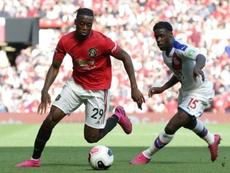 Bissaka ha brillado con luz propia en el United. AFP