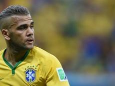 Dani Alves hopes to experience the Premier League. AFP