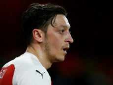 Ozil maintains healthy relationship with Emery. AFP
