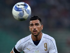 Italy's Graziano Pelle eyes the ball . AFP