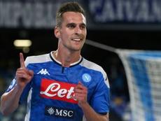 Milik se habría ganado la renovación con el Nápoles. AFP