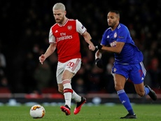 Mustafi (L) is more interested in football resuming than his Arsenal future. AFP