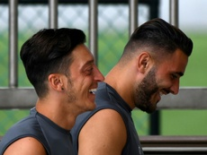 Ozil (L) went on holiday to Turkey before the FA Cup final. AFP