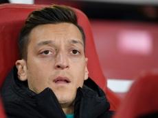 Özil tiene decidido quedarse hasta acabar su contrato. AFP