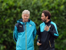 Pires and Wenger pictured in 2015. AFP