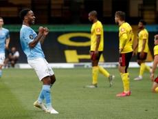 Sterling (2L) got two goals at Watford. AFP