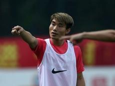 Zheng Zhi is still making history. AFP