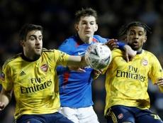Quatre cas positifs à Portsmouth, adversaire d'Arsenal en FA Cup. AFP