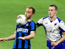Eriksen (L) had a dig at the Inter coach. AFP