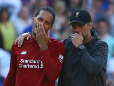 Van Dijk ruled out a move to Chelsea and City for Klopp. AFP