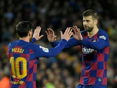 Gerard Pique (R) will become the new Barcelona captain. AFP