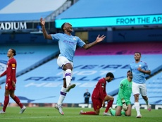 City profite de la gueule de bois de Liverpool. AFP
