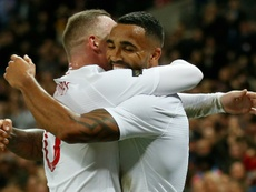 Wilson celebrates with Rooney after scoring against the USA. AFP