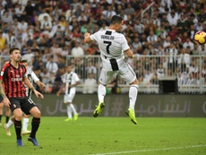 Cristiano Ronaldo rises to head home his 16th goal of the season. AFP