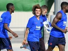 Griezmann espera con ansia empezar a entrenar junto a Messi. AFP/Archivo