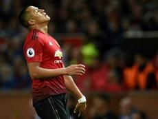 Alexis Sánchez semble regretter par moment son arrivée à United. AFP