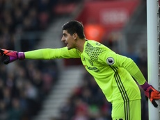 Chelsea's goalkeeper Thibaut Courtois standing in the goal. AFP