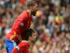 Spain's defenders Gerard Pique and Sergio Ramos celebrate after Pique scored the opening goal during the Euro 2016 match between Spain and Czech Republic on June 13, 2016