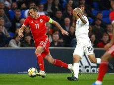 Gareth Bale is clearly a different person when he plays for Wales. AFP
