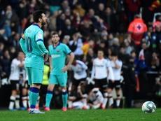 'AS': jugadores del Barça criticaron el estilo en el descanso. AFP