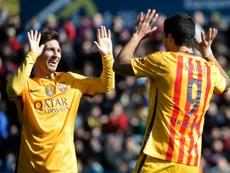 Messi, en una imagen de archivo, dio su primer triplete de asistencias en 2014 ante el Levante. AFP
