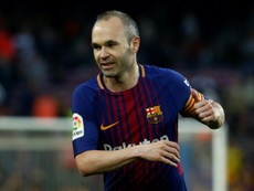 Iniesta is yet to reveal his destination. AFP