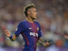 Neymar estava envolvido em processo movido pelo Santos contra o Barcelona. AFP
