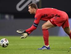 Neuer volvió a dejar la puerta a cero y 'goleó' a Kahn y a su récord. AFP