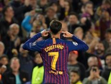 Coutinho a célébré son but en mettant les doigts dans ses oreilles. AFP