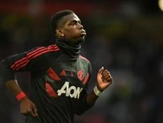 Pogba has had a turbulent time under Mourinho. AFP