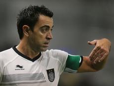 Xavi tiene un buen recuerdo de San Mamés. AFP