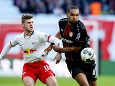 Werner (L) will face stiff competition to get into the Liverpool starting XI. AFP