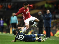 Depay fighting for the ball. AFP