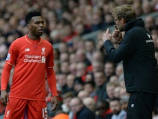 Klopp talking to Sturridge. AFP