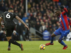 Christian Benteke was profligate in front of goal, but won a penalty. AFP
