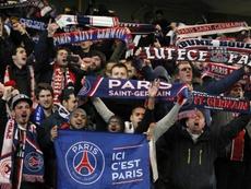 Paris Saint Germain fans set off fireworks during Wednesday's European cup match. AFP
