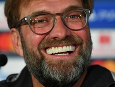 Klopp will stay on at Anfield. AFP