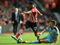 Hughes has called on Southampton fans to go easy on Redmond. AFP