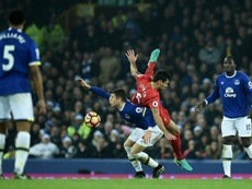 Lovren is challenged by Ross Barkley in the Merseyside derby. AFP