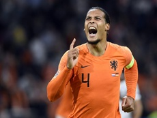 Virgil van Dijk celebrates after scoring the opening goal. AFP
